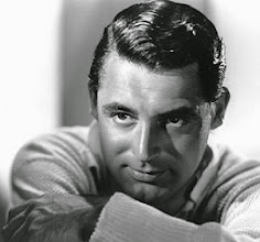 Photo: Cary Grant: shiny hair and skin. The skin is a bit shinier, less matte than was the norm for female stars.  There is less texture to focus away from the star's face. The sweater is finely detailed, but it's not crinoline or satin.
