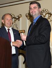 Photo: Outgoing President Simonsonpasses the gavel to incoming President Blackford.