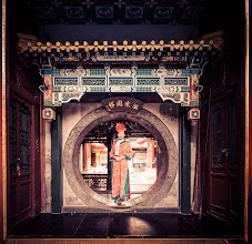 Photo: She brought Tom and I some food in this old ornate part of Beijing... I asked if I could take her pictures as she went through this circular portal...