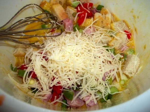 Add the toasted sour dough cubes, 1/2 the peppers, 3/4 cup cheese, ham and...