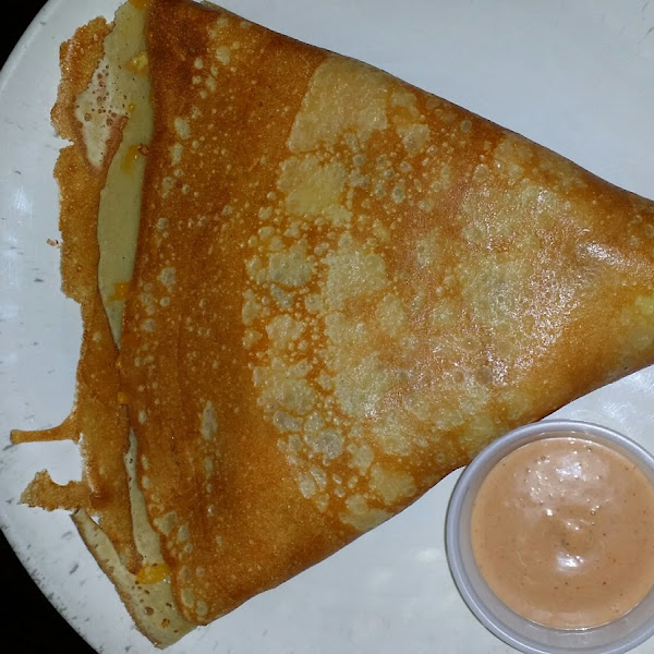 gluten free savory crepe with egg. bacon, and cheddar