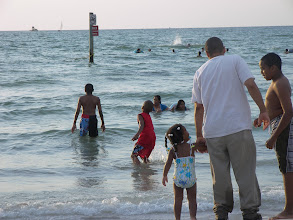 Photo: Miles , Izjan about to go for the good waves! Kaleya waiting to get her turn in the water.