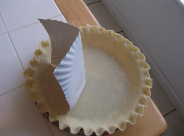 Divide the pie shell with a clean 6-in. square of cardboard or cut plate....