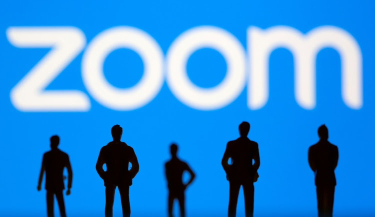 Small toy figures are seen in front of Zoom logo in this illustration picture taken March 15, 2021. Zoom and Russia are engaged in a battle that could see the service being banned in Russia.