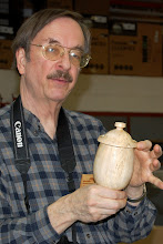 Photo: Gary Guenther shows a piece that he started in his class with Mark Gardner.  He decided he didn't want to carve it, and wanted to make it different from Mark's form, so ...