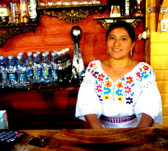 Photo: Our waitress in Otavalito restaurant, wearing typical Otavaleña blouse
