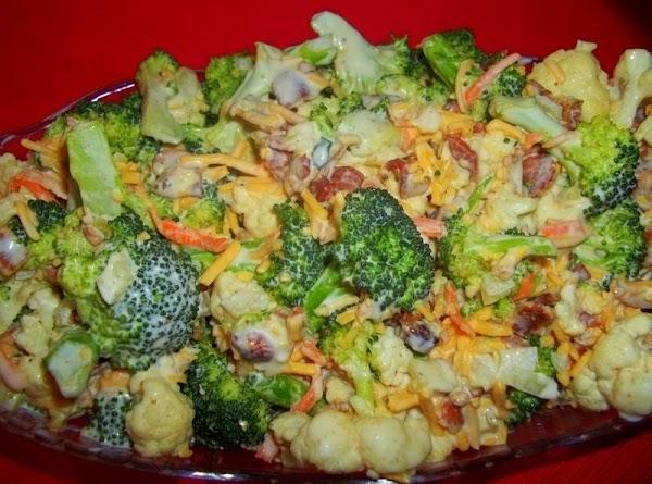 Mix together salad ingredients.  Mix together dressing ingredients. Pour over salad and stir till...