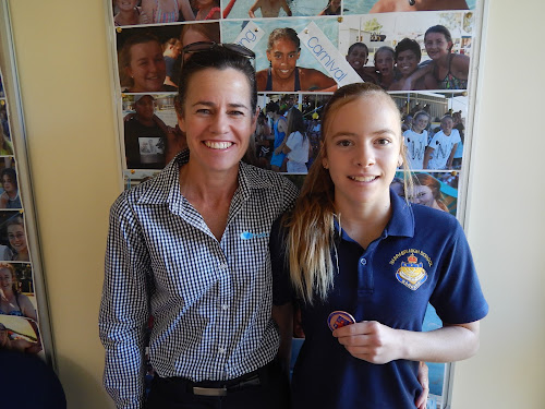 Ella Tomlinson, right, with her CHS bronze medal and her mother Allison Tomlinson.