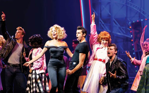 """Cast members during a performance of the musical """"Grease"""" on Harmony of the Seas."""