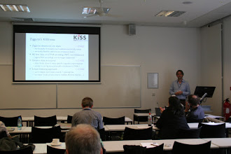 """Photo: Stefan Evert, Andrew Hardie, """"Ziggurat: A new data model and indexing format for large annotated text corpora"""", Stefan presenting"""
