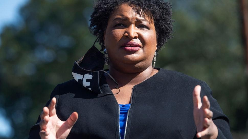 Stacey Abrams, former candidate for Georgia governor, speaks at campaign event for Rev. Raphael Warnock, Democratic candidate for Georgia senate, near Coan Park in Atlanta, Ga., on Tuesday, November 3, 2020.