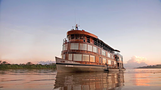 Delfin II sails down the Amazon River during a Lindblad expedition.