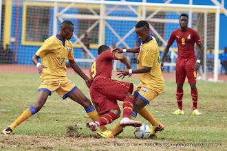 Photo: Jean-Baptiste MUGIRANEZA (7) and  Yannick MUKUNZI (6) close out Jordan Ayew (9) [Rwanda Vs Ghana AFCON2017 Qualifier, 5 Sep 2015 in Kigali, Rwanda.  Photo © Darren McKinstry 2015