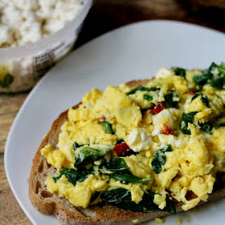 Cheesy Herbed Feta Scrambled Eggs with Spinach.