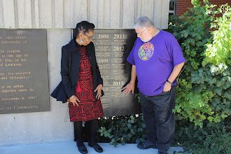 Photo: Dr.Doreatha Mbalia and Professor Patrick Bellegarde-Smith admiring the plaque on Professor Winston Van Horne at Spaight's Plaza.