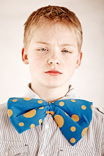 Photo: Portrait of dissatisfied young boy with large butterfly