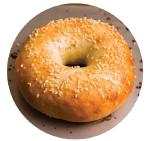 Bagel topped with sesame seeds on a baking sheet