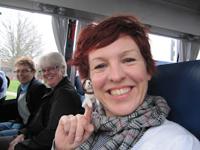 Photo: Our very own Cath McGourty, coordinator for the SIE program (posing with Doggie). Ann and Linda looking on (on bus on field trip to London)