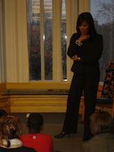 Photo: Micah Materre from WGN News chats with 4th graders before reading to them.
