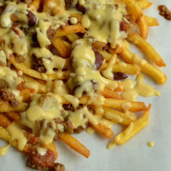 Easy Chili Cheese Fries Made With Crispy Fries, Thick Hearty Chili, And An Easy To Make Creamy Sharp Cheddar Cheese Sauce.