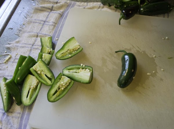 Cut the stem end off the jalapenos and Slice them in half lengthwise.