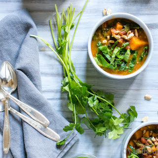 Sweet Potato Peanut Chipotle Soup with Wilted Greens