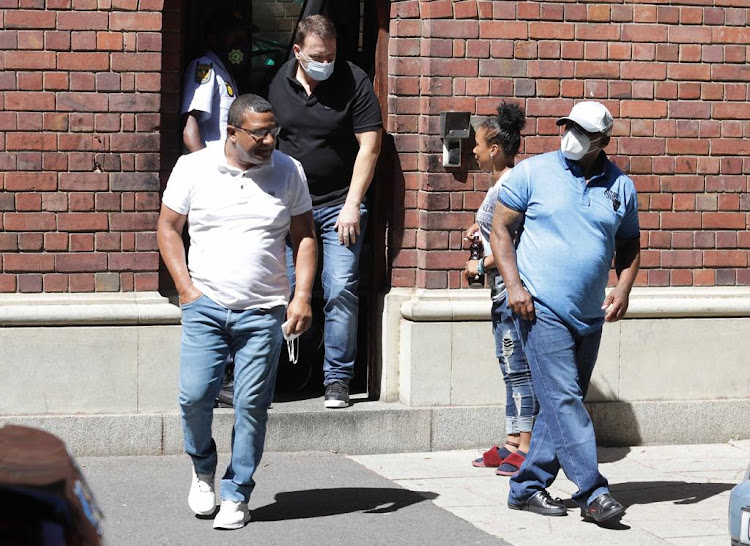 Jerome Booysen, Mark Lifman and William Steven leave the Cape Town magistrate's court after a court appearance in December.