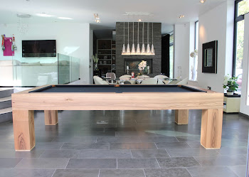 Side shot of Pool Table in an open home area