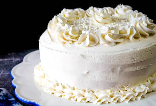 A Cake Iced With Yummy Vanilla Buttercream Frosting.