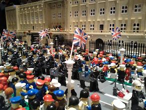 Photo: Palace and parade. Royal attendance on balcony.