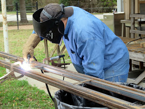 Photo: Pete Greene now welding engine barn rail together.   2014-0104 RPW