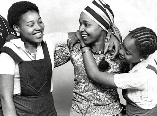 Winnie Mandela returns to her Soweto home in 1975 after six months in jail for contravening her banning order, to be greeted by her daughters, Zenani, 16, left, and Zindzi,14.