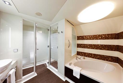 Norwegian-Escape-Corner-Suite-bathroom - A look at the spacious bathroom in one of Norwegian Escape's Corner Suites.