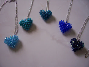 "Photo: Swarovski Crystal Heart. Size: 1"" x 1"" face and 1/2"" thick with 18"" chain. Color left to right: Aquamarine, Turquoise, Indicolite, Sapphire and Montana AB. $35.00 each."