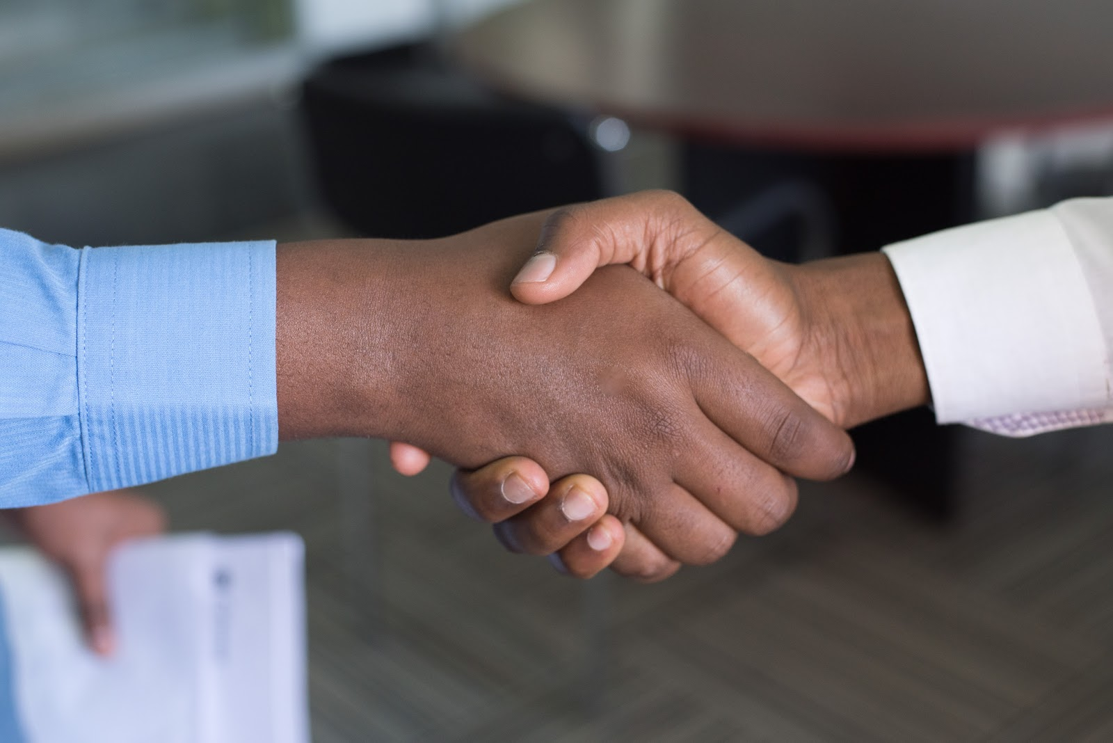 Shaking hands and build trust through brand awareness
