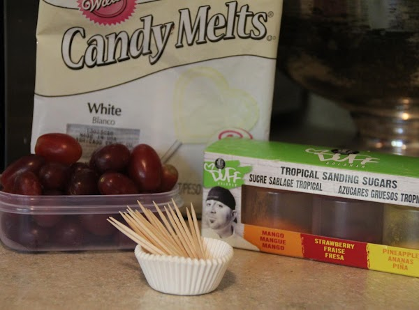 Wash grapes and try your best to dry them (makes candy melts stick better)....