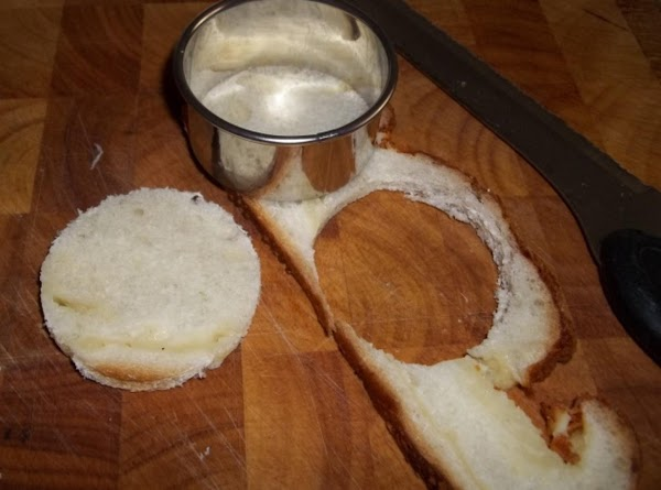 preheat oven to 450 degrees and using a biscuit cutter cut bread into circles...