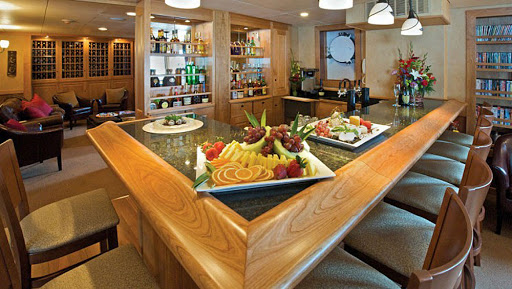 safari-explorer-bar.jpg - Passengers can find hors d'oeuvre, fine wines and cocktails in the bar aboard Safari Explorer.