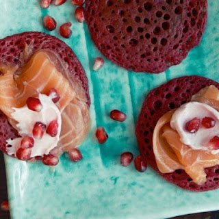 Beet Blinis with Salmon Marinated in Star Anise Syrup from 'Home Made Winter'.