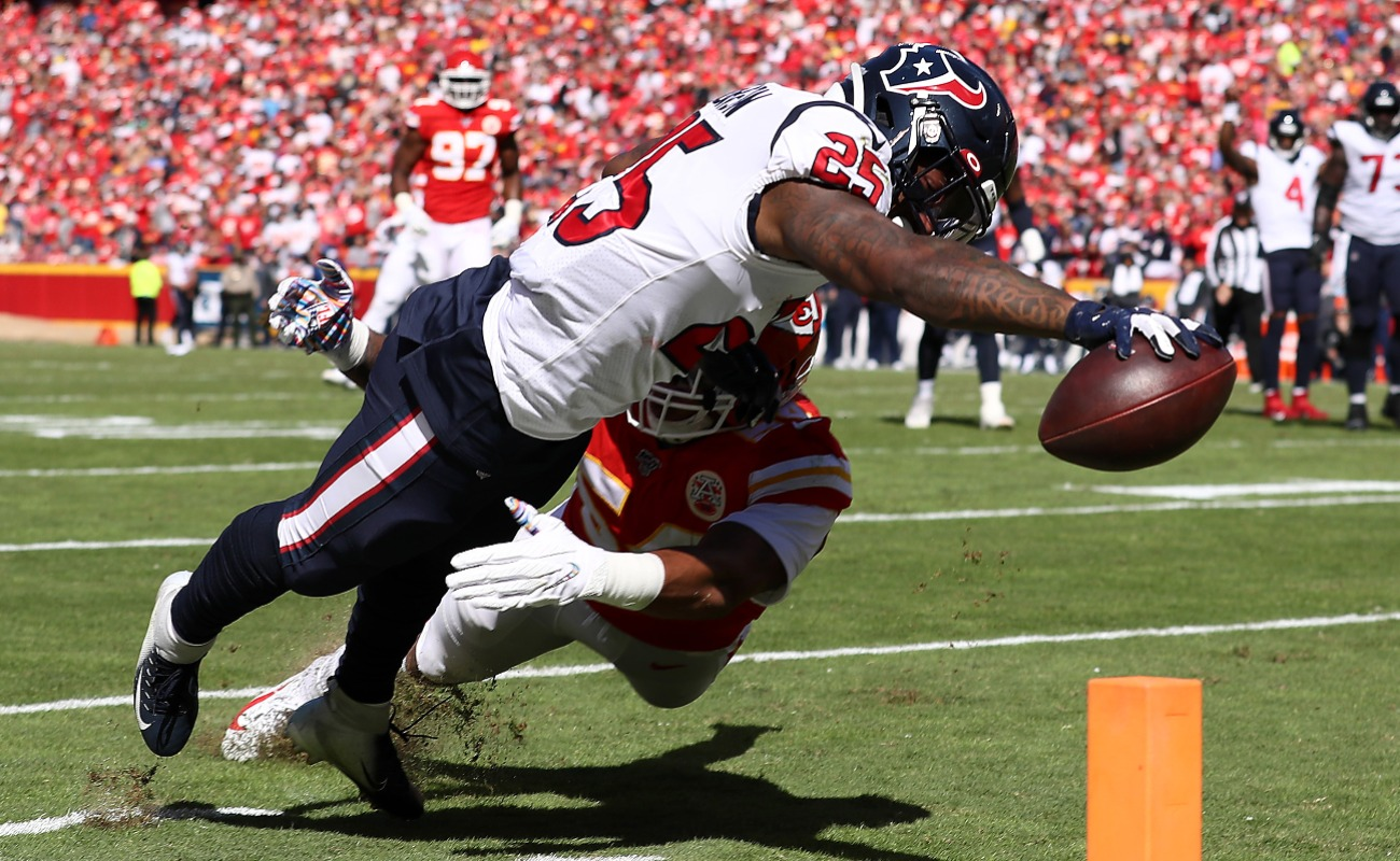 Duke Johnson #25 of the Houston Texans dives for the pylon to score a 11-yard receiving touchdown during the second quarter against the Kansas City Chiefs at Arrowhead Stadium on October 13, 2019 in Kansas City, Missouri.