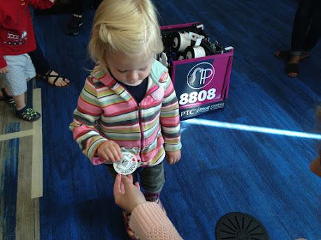 Visitor receiving their robot sticker