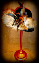 Photo: <KAPELUXE> Unique-Chique Hats by Luba Bilash ART & ADORNMENT  Midnight black wool felt fedora base; fox tail; feathers; grosgrain ribbon 360 degree possibilities. Can also be worn on an angle. Size L - 56 cm/22 in SOLD