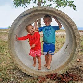 In The Circle by Geoffrey Wols - Babies & Children Toddlers ( vanuatu, girl, espiritu santo, grass, million dollar point, beach, baby, toddler, boy, pipe,  )