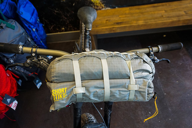 Fly Creek HV UL2 in stuff sack mounted to a bicycle on the handlebars