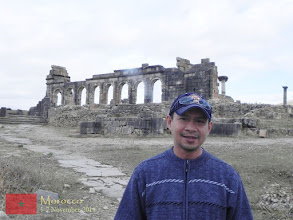 Photo: behind me is the ruin of the basilica in Volubilis