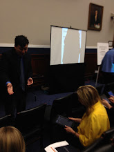Photo: Garron Hillaire speaking to Alexa Posny (former Assistant Secretary for Special Education and Rehabilitative Services) about CAST's iSolveIt apps (http://isolveit.cast.org/).