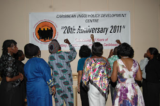 Photo: Participants signing CPDC banner at closing of Dinner
