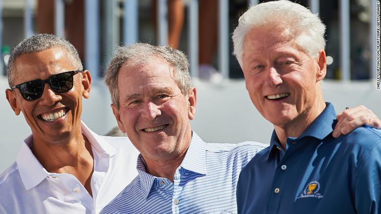 Former Presidents Obama, George W. Bush, and Bill Clinton pose for cameras during the 2017 Presidents Cup at Liberty National Golf Club in Jersey City, New Jersey.