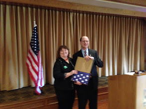 Photo: Cynthia Andrachick is presented a flag from Congressman Brad Sherman