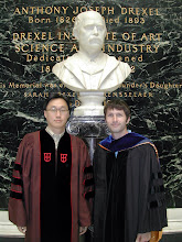 Photo: Drs. Kim and Steager with Their Regalia